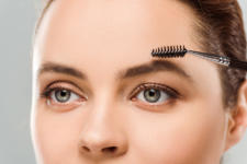 Cropped View Of Woman Shaping Eyebrow With Eyebrow Brush Isolate